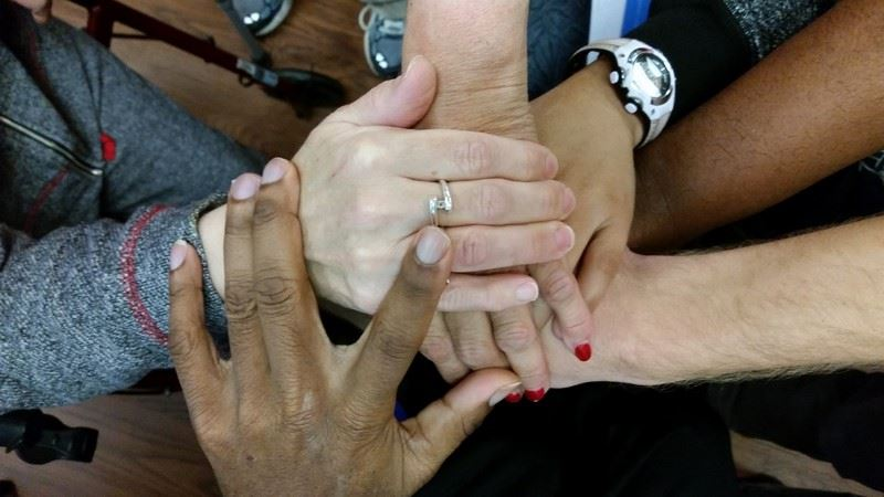 Photo of hands of Voices Matter Self-Advocacy Group